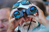 A fan watches through binoculars during the ICC Cricket World Cup one day pool match between the New Zealand Black Caps and England at Wellington Regional Stadium, Wellington, New Zealand on Friday, 20 February 2015. Photo: Dave Lintott / lintottphoto.co.nz