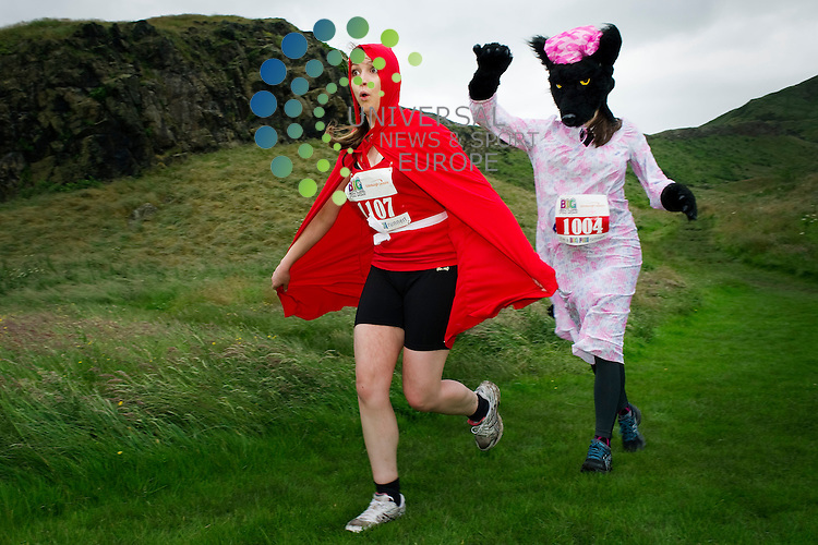 Edinburgh's Big Fun Run 5K event around Arthurs Seat in Holyrood Park, Edinburgh, Scotland, 15th July 2012. Pictured Lara Pennycott ( Red Riding Hood ) and Laura Henderson (Fox).Picture:Scott Taylor Universal News And Sport (Europe) .All pictures must be credited to www.universalnewsandsport.com. (Office)0844 884 51 22.