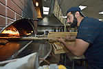 Hasan Abdulgader bakes bread in a restaurant in Harrisonburg, Virginia. A Kurdish refugee from Iraq, he was resettled in Harrisonburg by Church World Service.<br /> <br /> Photo by Paul Jeffrey for Church World Service.