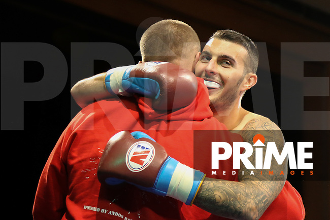George Harper (right) celebrates victory against Sean Lacey (not shown) during Battleground Boxing - Charity at Grays Civic Hall, Blackshots Lane, Grays, England on 5 September 2015. Photo by David Horn.