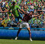 Seattle Sounders' Lemar Neagle fights for ball control against Colorado Rapids' Thomas Piermayr during an MLS match on April 26, 2014 in Seattle, Washington.  Neagle score a a goal as the Seattle Sounders beat the Colorado Rapids 4-1.  Jim Bryant Photo. ©2014. All Rights Reserved.