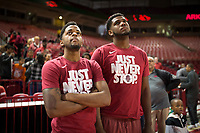 NWA Democrat-Gazette/CHARLIE KAIJO Arkansas Razorbacks guard Daryl Macon (left) and forward Trey Thompson (right) watch the NCAA selection show, Sunday, March 11, 2018 at Bud Walton Arena in Fayetteville. The Razorbacks will play Butler in Detroit on Friday