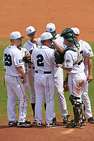 Dartmouth Big Green head coach Bob Whalen (2) during a mound visit with (clockwise) third baseman Steffen Torgersen (29), shortstop Justin Fowler (25), second baseman Dustin Shirley (6), starting pitcher Michael Danielak (34), first baseman Joe Purritano (3), and catcher Adam Gauthier (18) during a game against the South Florida Bulls on March 27, 2016 at USF Baseball Stadium in Tampa, Florida.  South Florida defeated Dartmouth 4-0.  (Mike Janes/Four Seam Images)