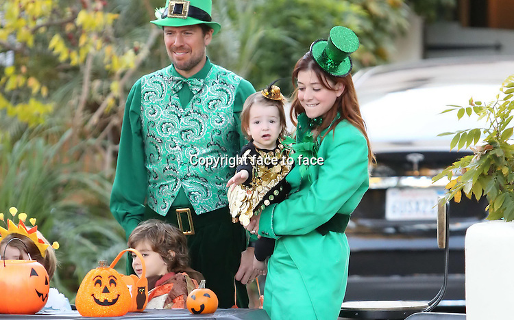 Alyson Lee Hannigan and Alexis Denishof with their kids Satyana_Marie_Denisof and Keeva Jane Denisof on Halloween, 31.10.2013<br /> Credit: Vida/face to face