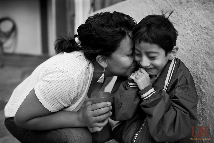 Mateo having a moment with his mom Liliana, in the front yard of their house.