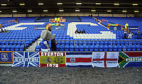 Pictured: The Everton mascon walks past Everton flags. Sunday 16 February 2014<br />