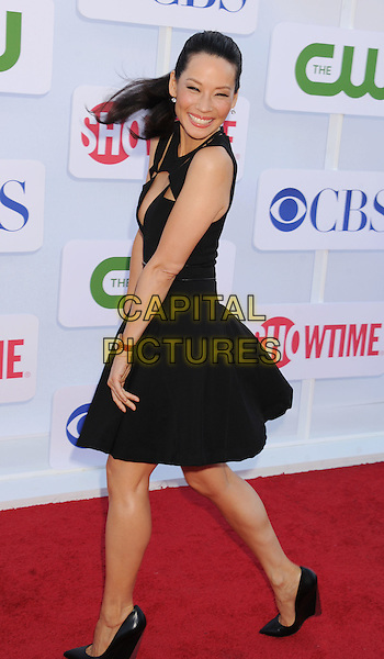 Lucy Liu.CBS, CW, Showtime 2012 Summer TCA Party held at The Beverly Hilton Hotel, Beverly Hills, California, USA..July 29th, 2012.full length dress black cut out away low cut neckline cleavage sleeveless side smiling .CAP/ROT/TM.©Tony Michaels/Roth Stock/Capital Pictures