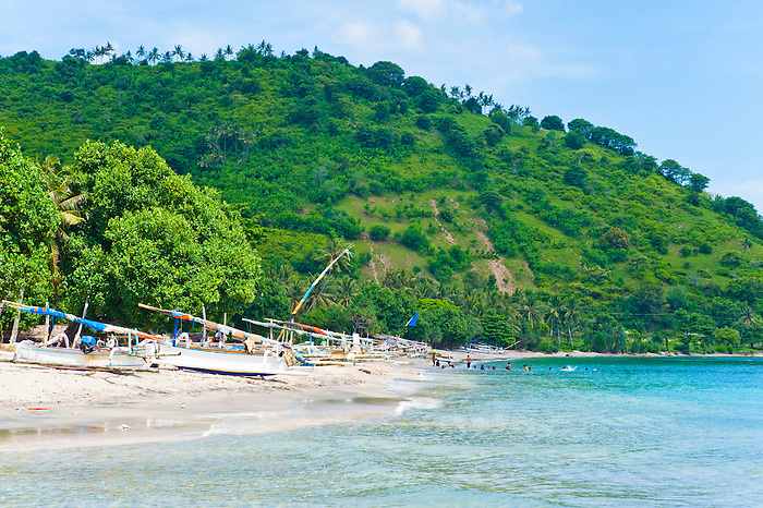 Group Of People Swimming At Nippah Beach On Lombok A Tropical Island In West Nusa
