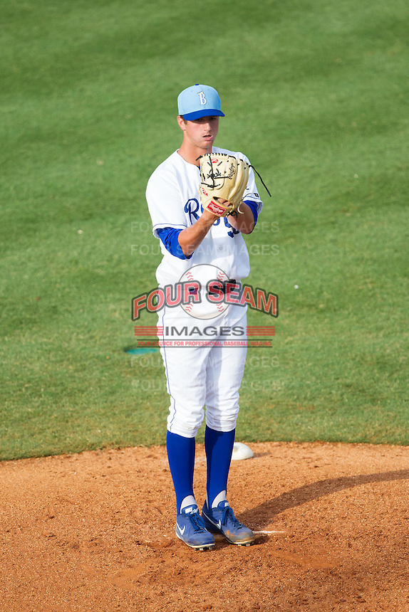 Burlington Royals starting pitcher Foster Griffin (55) looks to his catcher for the sign against the Greeneville Astros at Burlington Athletic Park on June 29, 2014 in Burlington, North Carolina.  The Royals defeated the Astros 11-0. (Brian Westerholt/Four Seam Images)