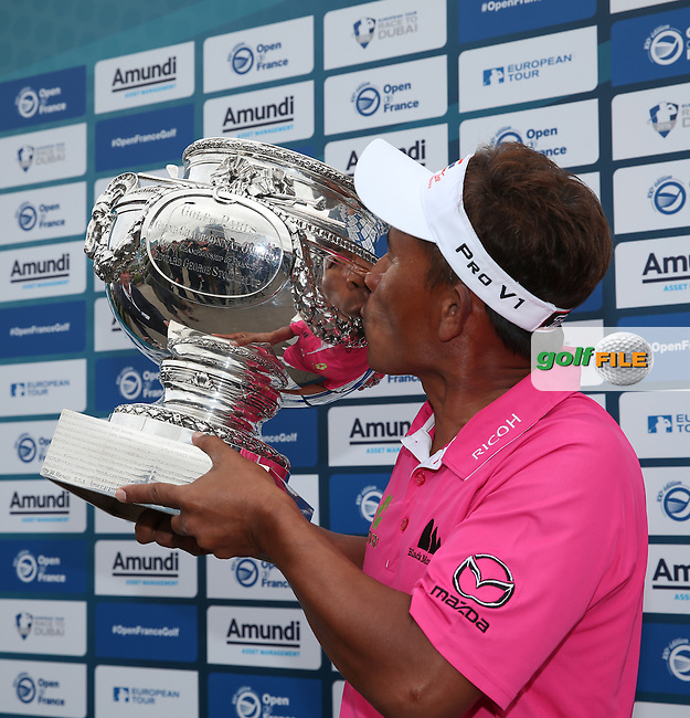 Thongchai Jaidee (THA) kissing the Edward George Stoiber Cup and winning the Final Round of the 100th Open de France, played at Le Golf National, Guyancourt, Paris, France. 03/07/2016. Picture: David Lloyd | Golffile.<br /> <br /> All photos usage must carry mandatory copyright credit (&copy; Golffile | David Lloyd)