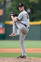 Starting pitcher Kyle Cody (23) of the Hickory Crawdads delivers a pitch in a game against the Greenville Drive on Sunday, July 16, 2017, at Fluor Field at the West End in Greenville, South Carolina. Hickory won, 3-1. (Tom Priddy/Four Seam Images)