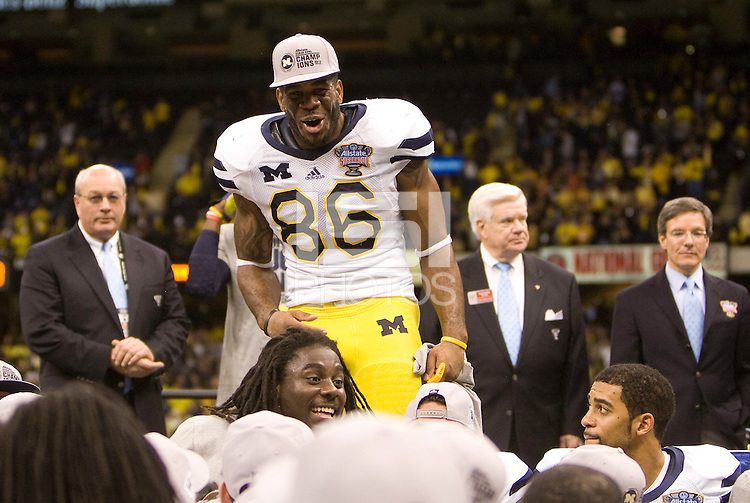 Kevin Koger of Michigan celebrates after winning Sugar Bowl game against Virginia Tech at Mercedes-Benz SuperDome in New Orleans, Louisiana on January 3rd, 2012.  Michigan defeated Virginia Tech, 23-20 in first overtime.