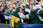 Ruvell Martin #82 of the Green Bay Packers celebrates his touchdown with a Lambeau Leap during an NFL football game against the Minnesota Vikings at Lambeau Field on November 11, 2007 in Green Bay, Wisconsin. The Packers beat the Vikings 34-0. (Photo by David Stluka)