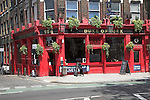 Bright red painted traditional public house, The Duke of York pub, 156 Clerkenwell Road, Camden, London, England