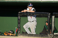 Kannapolis Intimidators bat boy Allan Westerholt hangs out in the visitors dugout prior to the game against the Greensboro Grasshoppers at CMC-Northeast Stadium on August 1, 2015 in Kannapolis, North Carolina.  The Intimidators defeated the Grasshoppers 7-4.  (Brian Westerholt/Four Seam Images)