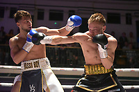 Yaser Al Ghena (white/black) shorts) defeats Lee Hallett during a Boxing Show at York Hall on 8th September 2018