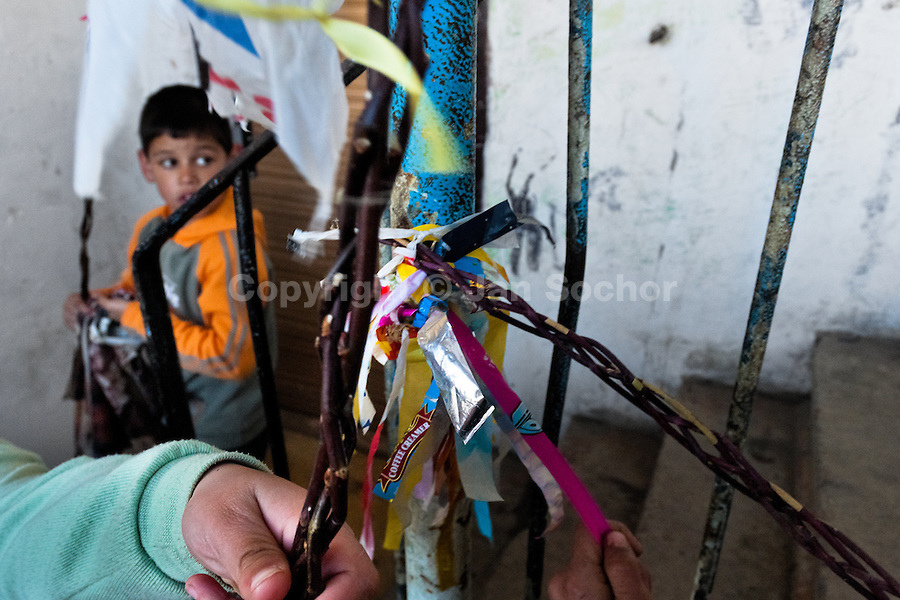 Children, holding whips made from pussywillow twigs and decorated with ripped plastic bags, seen during the Easter in the Gipsy ghetto of Chanov, Most, Czech Republic, 26 March 2008.