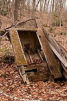 Old Out house tipped over in the forest