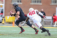 College Park, MD - November 26, 2016: Maryland Terrapins quarterback Perry Hills (11) avoids Rutgers Scarlet Knights defensive lineman Ron'Dell Carter (90) during game between Rutgers and Maryland at  Capital One Field at Maryland Stadium in College Park, MD.  (Photo by Elliott Brown/Media Images International)