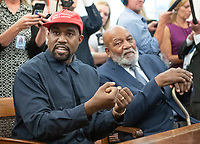 Kanye West, left, makes a statement to the media as he meets with United States President Donald J. Trump and Jim Brown, right, in the Oval Office of the White House in Washington, DC on Thursday, October 11, 2018.<br /> Credit: Ron Sachs / CNP /MediaPunch