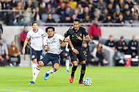 LOS ANGELES, CA - MARCH 08: Jose Martinez #8 of Philadelphia Union and Mark-Anthony Kaye #14 of LAFC compete for the ball during a game between Philadelphia Union and Los Angeles FC at Banc of California Stadium on March 08, 2020 in Los Angeles, California.