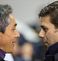 Fiorentina Head Coach Paulo Sousa & Tottenham Hotspur Manager Mauricio Pochettino come face to face during the UEFA Europa League 2nd leg match between Tottenham Hotspur and Fiorentina at White Hart Lane, London, England on 25 February 2016. Photo by Andy Rowland / Prime Media images.