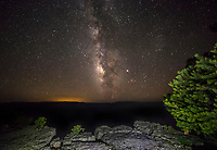 The Milky Way Galaxy appears over the Grand Canyon, Arizona
