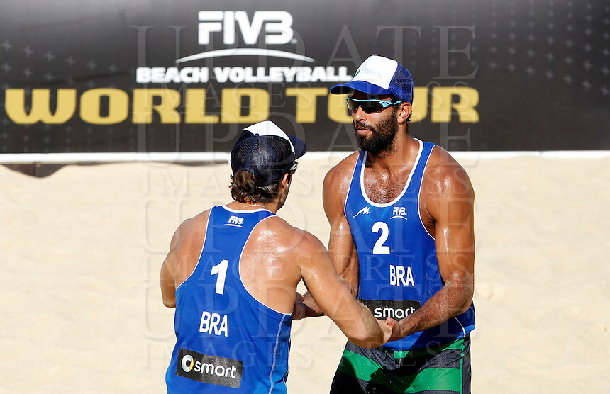 Brazil's Bruno Schmidt, left, and Pedro Solberg celebrate at the Beach Volleyball World Tour Grand Slam, Foro Italico, Rome, 22 June 2013. Brazil defeated Germany 2-0.<br /> UPDATE IMAGES PRESS/Isabella Bonotto