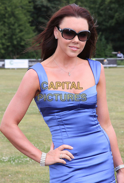 MICHELLE HEATON .Duke Of Essex Polo Trophy at Gaynes Park, Epping, Essex, England, UK,.July 4th 2009..half length blue dress hand on hip bracelet ring silver cross necklace sunglasses .CAP/ROS.©Steve Ross/Capital Pictures