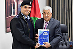 Palestinian President Mahmoud Abbas receives Palestinian police achievements report at his headquarters in the West Bank city of Ramallah on February 27, 2018. Photo by Osama Falah