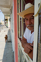 A man looks out his window in Teocelo, Veracruz. April 4, 2008