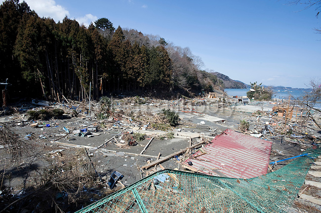 Photo shows the battered remains of a community on the Oshika Peninsula, Miyagi Prefecture, Japan on 19 March, 2011.  Photographer: Robert Gilhooly