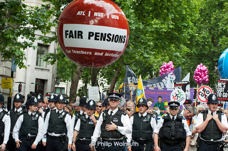 Heavily policed demonstration by striking public sector workers over planned pension changes.
