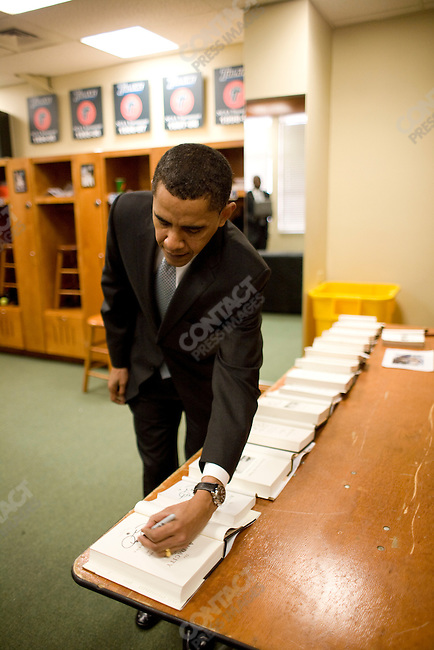 Senator Barack Obama, Democratic contender for the Presidential nomination, campaigns in New Orleans, Louisiana. Speaking at Tulane University (and back stage, collecting his thoughts before entering the arena). Afterwards, signing a row of books for people who attended the rally, February 7, 2008