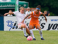 Sky Blue FC  forward Natasha Kai (6) knocks St Louis Athletica Elise Weber (12) away from the ball during a WPS match at Anheuser-Busch Soccer Park, in St. Louis, MO, June 7, 2009. Athletica won the match 1-0.