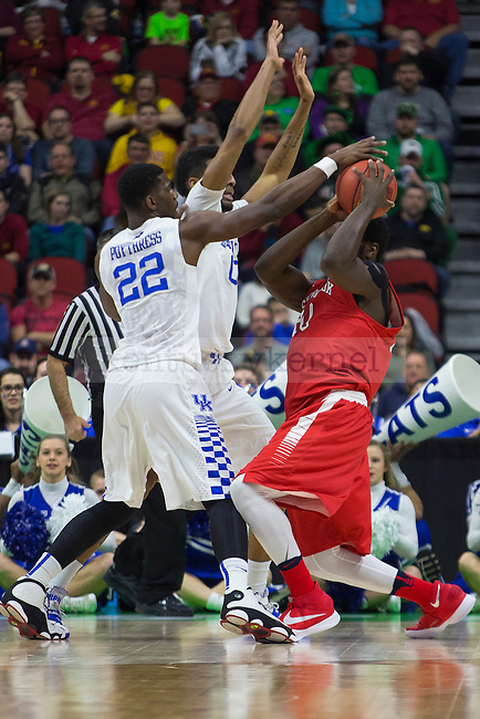 Forward Alex Poythress and Forward Marcus Lee of the Kentucky Wildcats play tight defense during the NCAA Tournament first round game against the Stony Brook Seawolves at Wells Fargo Arena on Thursday, March 17, 2016 in Des Moines, Iowa. Photo by Michael Reaves | Staff.