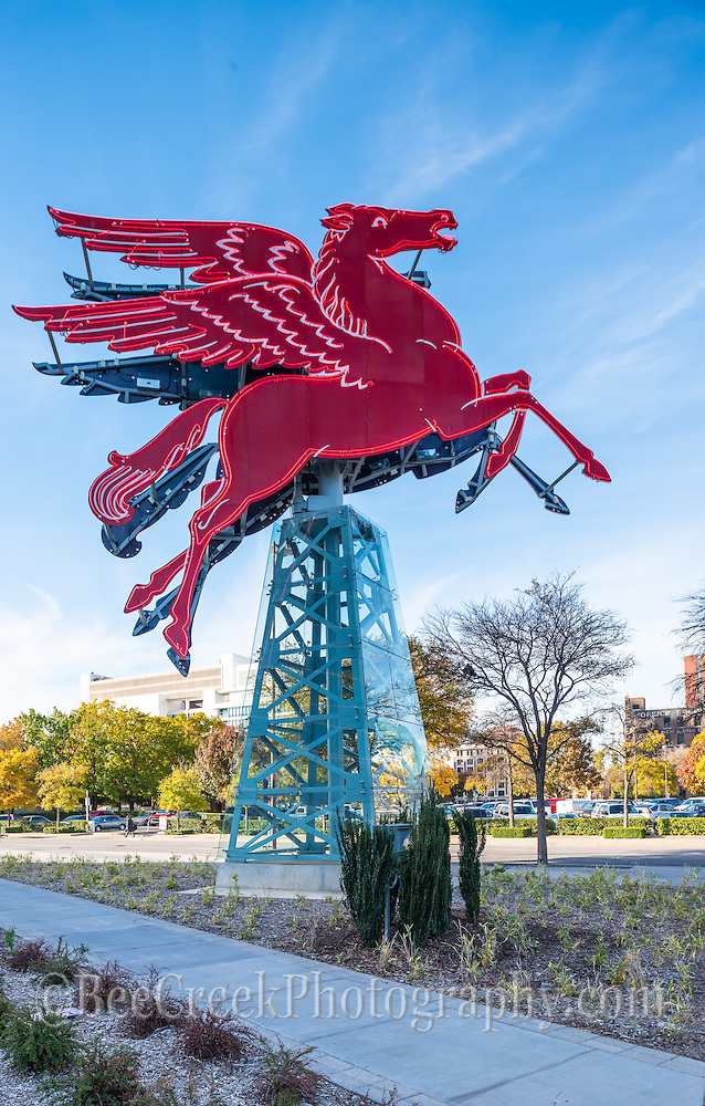 Here is another capture of the Red Flying Horse or Pegasus sitting on top of an oil derrick which rotates for different views.  This neon Pegasus had sat on top of the Magnolia Hotel since the 1930 till it had to be taken down because of damage. The neon horse was restore by the Omni Hotel and today the red giant ornaments looked kind of nice and the cityscape of the Reunion tower in the background for another cityscape image of downtown. This was the orginal symbol of the Magnolia Oil Company