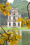 Tortoise Tower 04 - The historic Tortoise Tower seen through autumn leaves, Thap Rua, on an island in Hoan Kiem Lake, Hanoi, Vietnam
