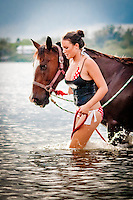 Swimming with horses, horse surfing, Palma Sola Bay, Bradenton, Florida, USA. Photo by Debi Pittman Wilkey