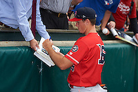 Louisville Bats pitcher Nick Routt (16) signs autographs before a game against the Buffalo Bisons on June 23, 2016 at Coca-Cola Field in Buffalo, New York.  Buffalo defeated Louisville 9-6.  (Mike Janes/Four Seam Images)