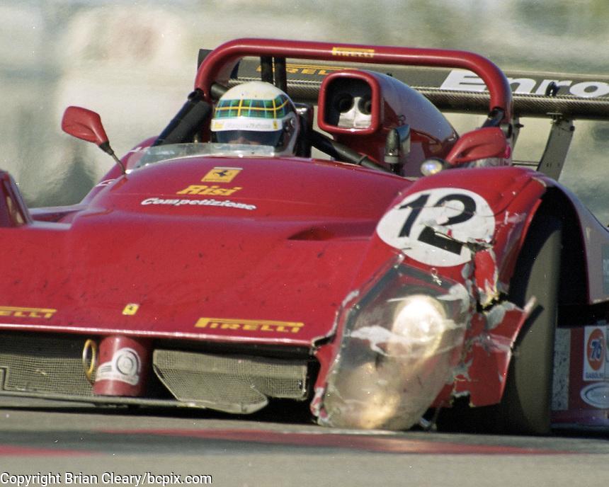 The damaged #12 Ferarri 333SP of Alex Cafi, Allann McNish, Ralf Kelleners, and Mimmo Schiattarella races to a 69th place finish in the Rolex 24 at Daytona, Daytona International Speedway, Daytona Beach, FL, February 2000.  (Photo by Brian Cleary/www.bcpix.com)
