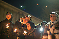 North Carolina State University students Nida Allam (middle left) and Safah Mahate grieve with thousands who gathered for a vigil and memorial for three shooting victims at The Pit at The University of North Carolina at Chapel Hill in Chapel Hill, North Carolina on Wednesday, February 11, 2015. Craig Hicks, 46, of Chapel Hill has been charged with three counts of first-degree murder in the killings of Deah Barakat, 23, a UNC student; his wife, Yusor Abu-Salha, 21; and her sister, Razan Abu-Salha, 19. (Justin Cook)