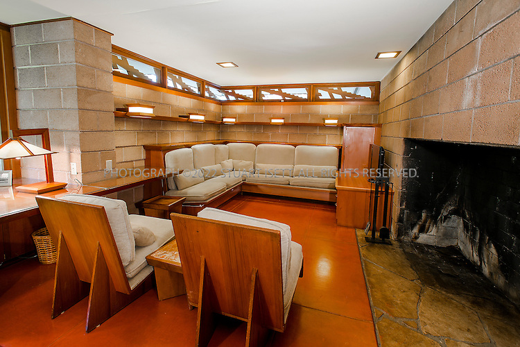 "10/9/2012--Sammamish, WA, USA..VIEW: Interior with . living room area and TV....Architect Frank Lloyd Wright planned his ""Usonian"" homes to be affordable for middle-class families. The 1,9500 square foot Brandes home is for sale in Sammamish, Washington (30 minutes from Seattle) at $1.39 million. It features three bedrooms, two bathrooms and a small, separate office/study space...The home was built in 1952, and has redwood trim and Wright's original furniture and some garden sculptures by Wright. It's one of only three Frank Lloyd Wright homes near Seattle...©2012 Stuart Isett. All rights reserved."
