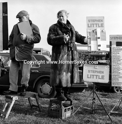 Hare Coursing...Stephen Little, a well known bookmaker, wears a fur coat at the Waterloo Cup. Near Altcar, Lancashire...Hunting with Hounds / Mansion Editions (isbn 0-9542233-1-4) copyright Homer Sykes. +44 (0) 20-8542-7083. < www.mansioneditions.com >..