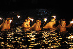 Shirahama Ama Matsuri summer festival where Amas (women who dive for fishing shells) get into the ocean at night with a stick on fire and their basket to pick up shells. Shirahama. Chiba Japan.
