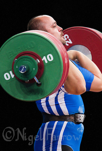 11 DEC 2011 - LONDON, GBR - Ferenc Gyurkovics (HUN) lifts during the men's +105kg category Clean and Jerk of the London International Weightlifting Invitational and 2012 Olympic Games test event held at the ExCel Exhibition Centre in London, Great Britain .(PHOTO (C) NIGEL FARROW)