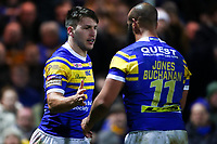 Picture by Alex Whitehead/SWpix.com - 08/03/2018 - Rugby League - Betfred Super League - Leeds Rhinos v Hull FC - Emerald Headingley Stadium, Leeds, England - Leeds' Tom Briscoe celebrates his try with Jamie Jones-Buchanan.