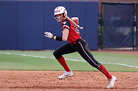 GREENSBORO, NC - MARCH 11: Kara Apato #16 of Northern Illinois University takes a lead off of first base during a game between Northern Illinois and UNC Greensboro at UNCG Softball Stadium on March 11, 2020 in Greensboro, North Carolina.