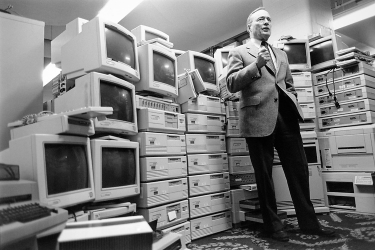 Rep. William Reynolds Archer, R-Tex. standing infront of computer equipment that Ways and Means Committee returning to Congress for use by other Committee and Members. February 8, 1995. (Photo by CQ Roll Call)