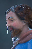 A statue of Joseph in a manger scene wears a patina of ice and icicles hang from his face in Westerville, Ohio, Thursday, December 23, 2004. A winter storm covered central Ohio with as much as a foot of snow and an inch of ice forcing school and business closings.